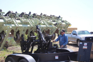 Mike Winemiller, agronomist with the strip-till equipment rental program unloads implement  for use by first-time CT farmer