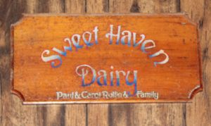 "Wood sign reading ""Sweet Haven Dairy"""