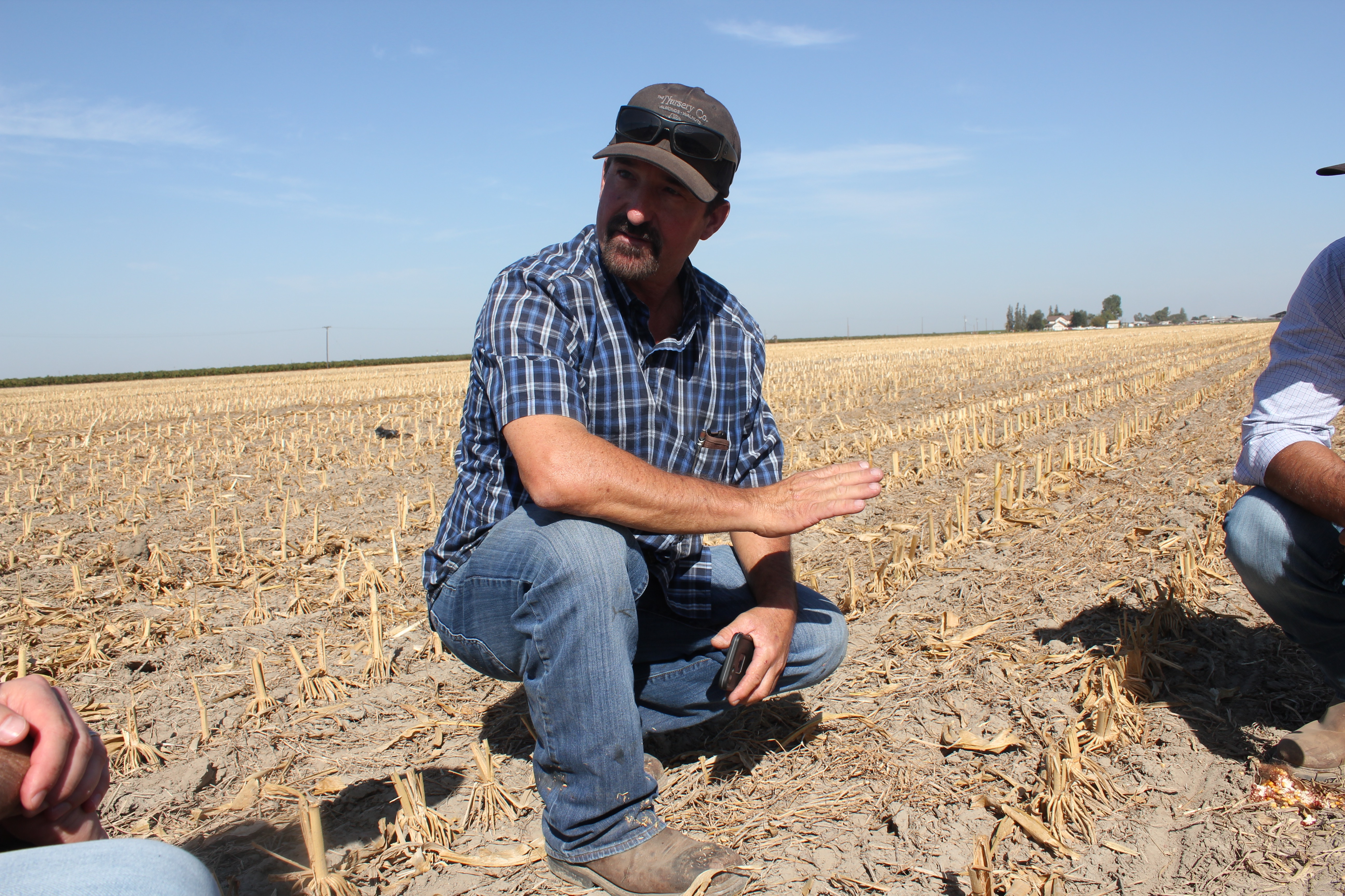 Andy Rollin explains conservation tillage to onlookers