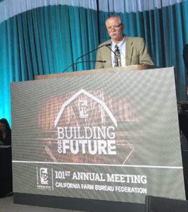 Bruce Rominger accepts LCA award at podium